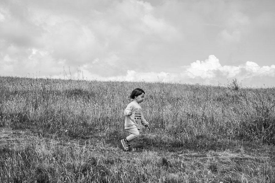 Black and white photo of boy running