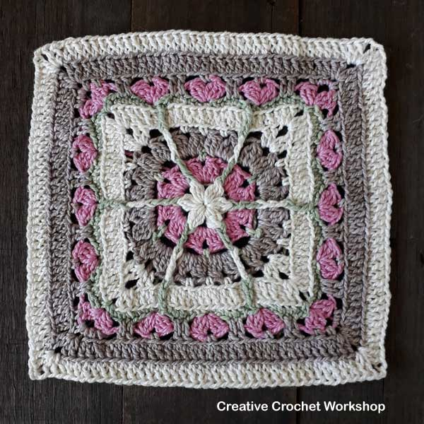 Snuggled Hearts Baby Blanket Part Three | Creative Crochet Workshop @creativecrochetworkshop #crochetalong #grannysquare #afghansquare #crochetbabyblanket #ccwsnuggledheartsblanket #madewithheart
