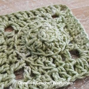 Mini Swirly Square - Free Crochet Pattern   Creative Crochet Workshop @creativecrochetworkshop #freecrochetpattern #grannysquare #afghansquare #crochetalong #ccwscrapsrificrainbowblanket
