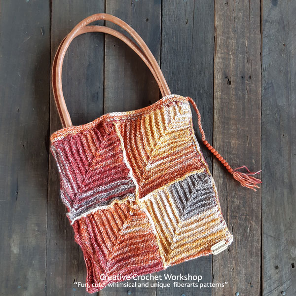 Knitted Rustic Mitered Squares Bag - Free Knit Pattern | Creative Crochet Workshop #freeknitpattern #knit #knitaccessory #knittedbag @creativecrochetworkshop
