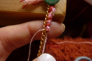 {handmade golden bracelet with coloured thread and seed beads in progress}
