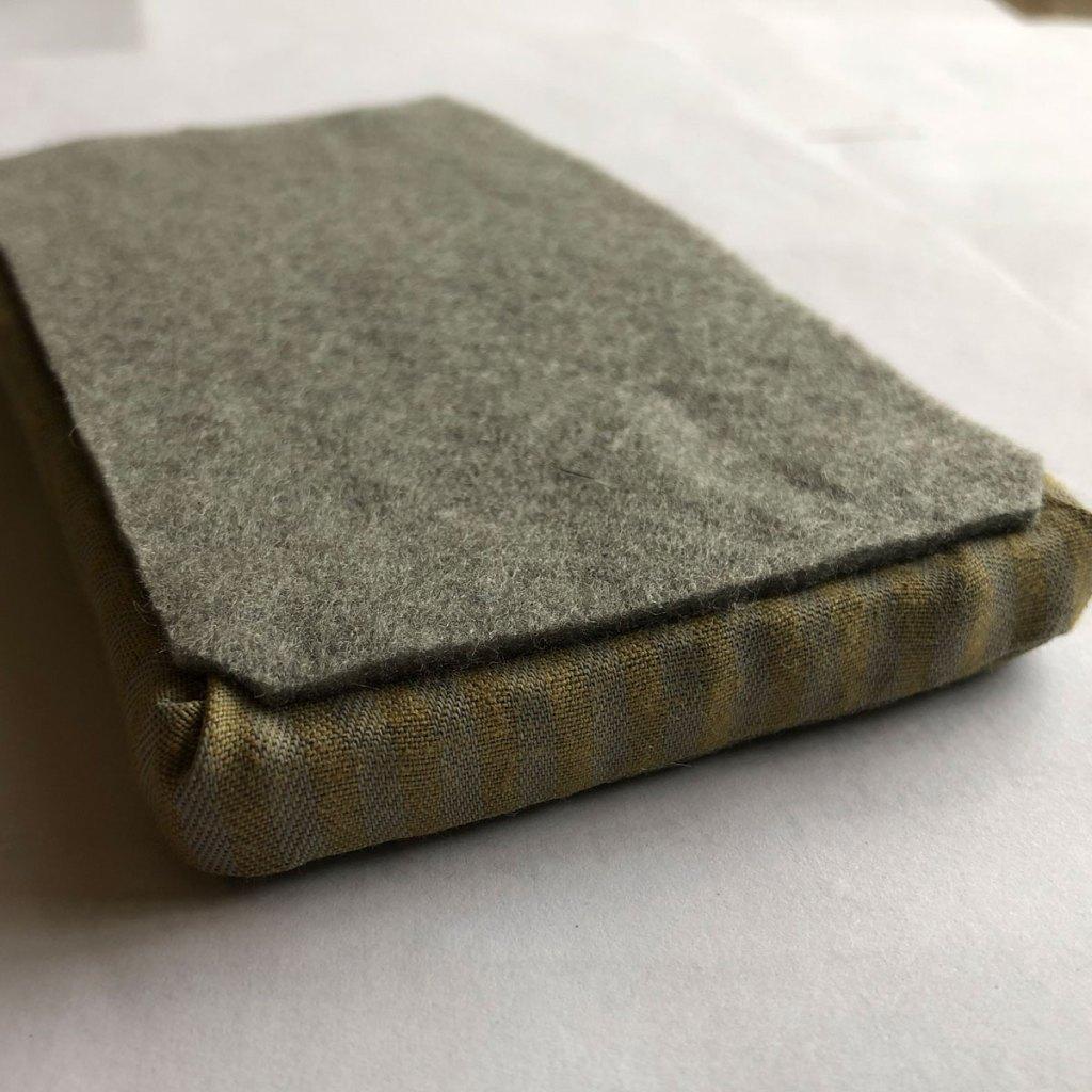 reverse side of dollhouse mattress