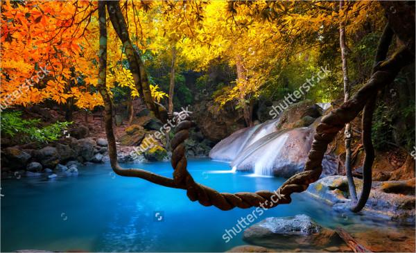 Tropical Waterfall Flows Through Dense Jungle