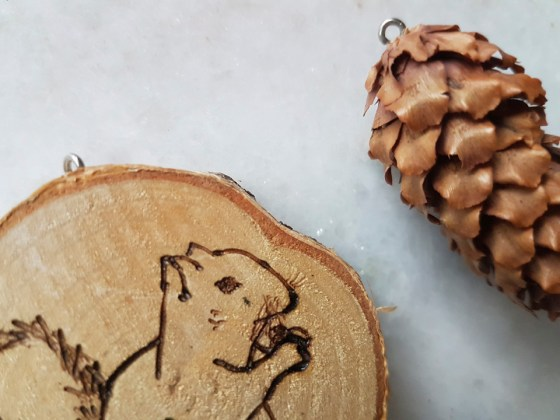 a picture of pyrography pen art on wood