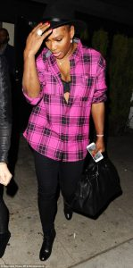 Serena Williams get Raunchy,flashes her black bra and ample cleavage in unbuttoned hot pink shirt as she enjoys a night out in LA