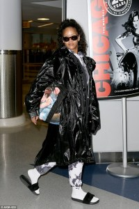 Moving on? Rihanna looks Flawless in Make Free arriving at the JFK Airport