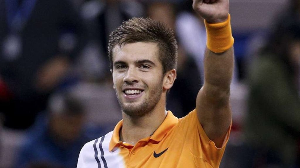 Coric upset defending champion Federer , plays Djokovic at Shanghai Masters final