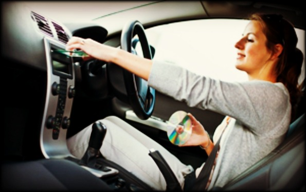 female-driver-playing-music