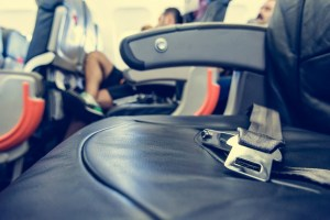 Airplane interior. Close up of safety belt on seat.
