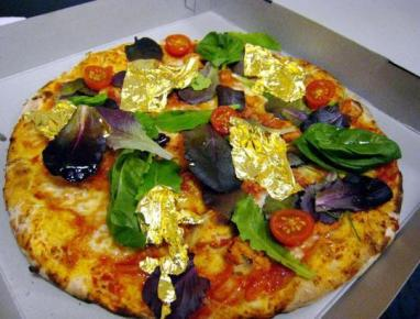"""Domenico Crolla's """"Pizza Royale 007″ – $4200 The 12 inch pizza pie is densely packed with an assortment of some of the world's most expensive food ingredients, such as lobster marinated in"""