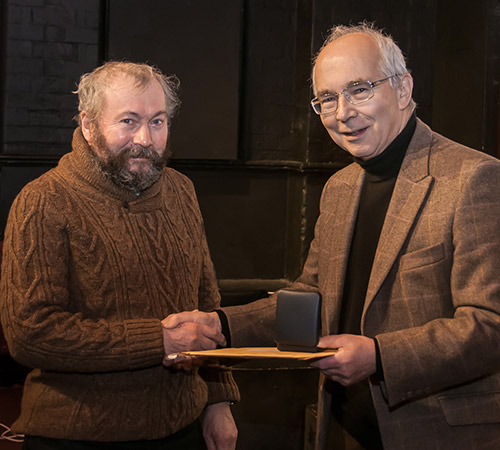 Ian receiving his medal from Richard Bifield. Photo by John Sweetland