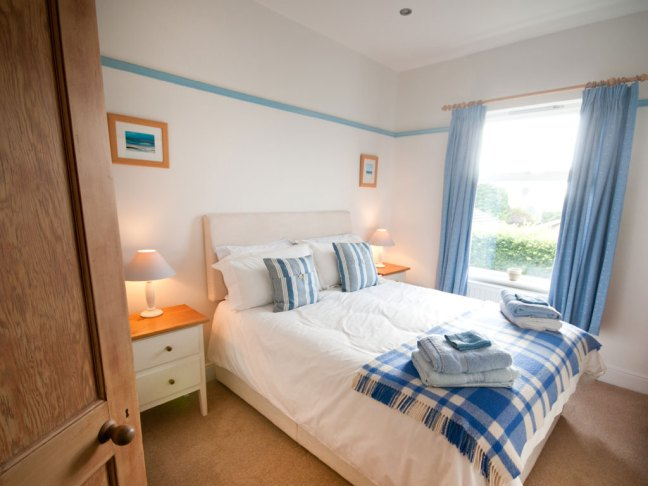 Blue bedroom with king size bed