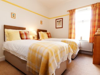 The yellow room showing twin beds