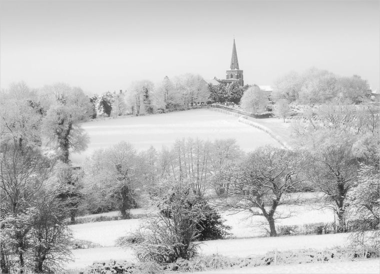 Winter snow and hoar frost covers this view of St Mary's, Crich, from Moredge