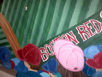 Red Sox fan with a pink baseball hat