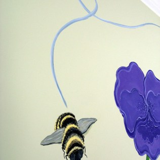 The path of the buzzing bee works it way down from the ceiling ....from the other wall