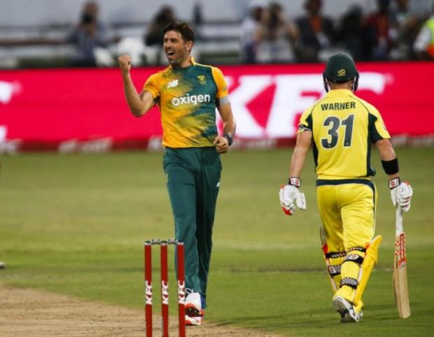 South Africa's Wiese celebrates the wicket of Australia's Warner during their first T20 International cricket match in Durban