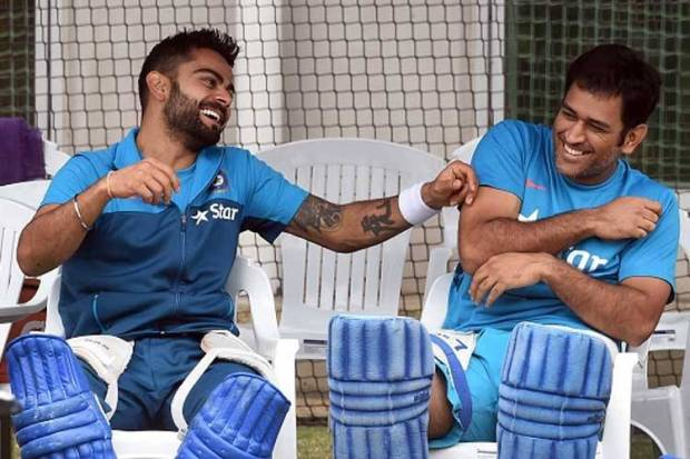 Kohli and Dhoni having fun during practice