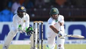 Bangladesh cricketer Sabbir Rahman (R) plays a shot as Sri Lankan wicketkeeper Niroshan Dickwella