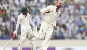 Nathan Lyon of Australia celebrates taking the wicket of Mushfiqur Rahim