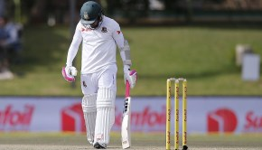 Bangladesh batsman Mushfiqur Rahim leaves the ground after South Africa fielder Temba Bavuma caught him out