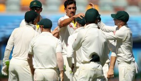 Mitchell Starc of Australia celebrates after taking the wicket of Chris Woakes of England
