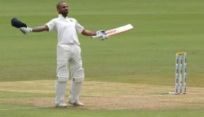 Shikhar Dhawan of India celebrates his Hundred