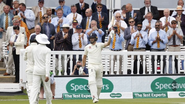England's Chris Woakes acknowledges the applause from the members