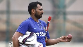 Indian cricketer Mohammed Shami leaves after batting in the nets during a training camp