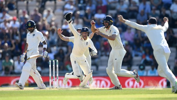 India captain Virat Kohli is caught out by Alastair Cook