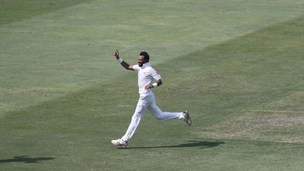 Pakistan cricketer Bilal Asif celebrates after taking the wicket of Australian batsman Usman Khawaja