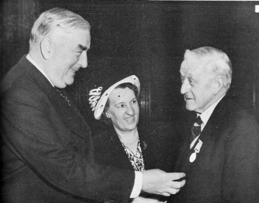 Australian Prime Minister Robert Menzies honouring Bill Ferguson with the British Empire Medal (courtesy: Wikimedia Commons).