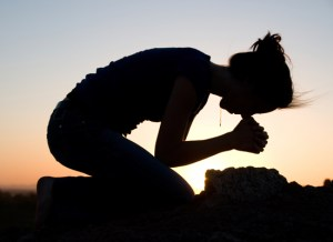 kneeling in prayer 2
