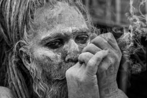 sadhu smoking kumbh mela india