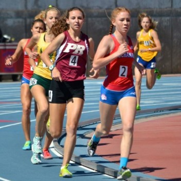Davis races next to Buchanan's mile runner finishing second, breaking the school record with a time of 5:02.09.