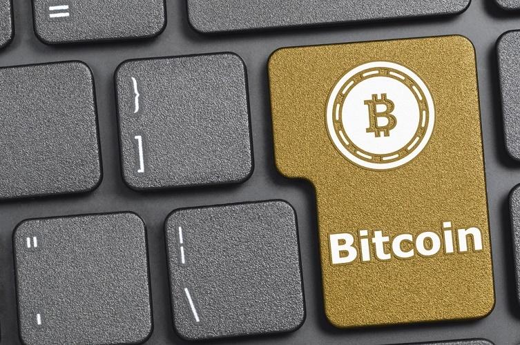 Símbolo monetario de Bitcoin no llegará todavía a los teclados