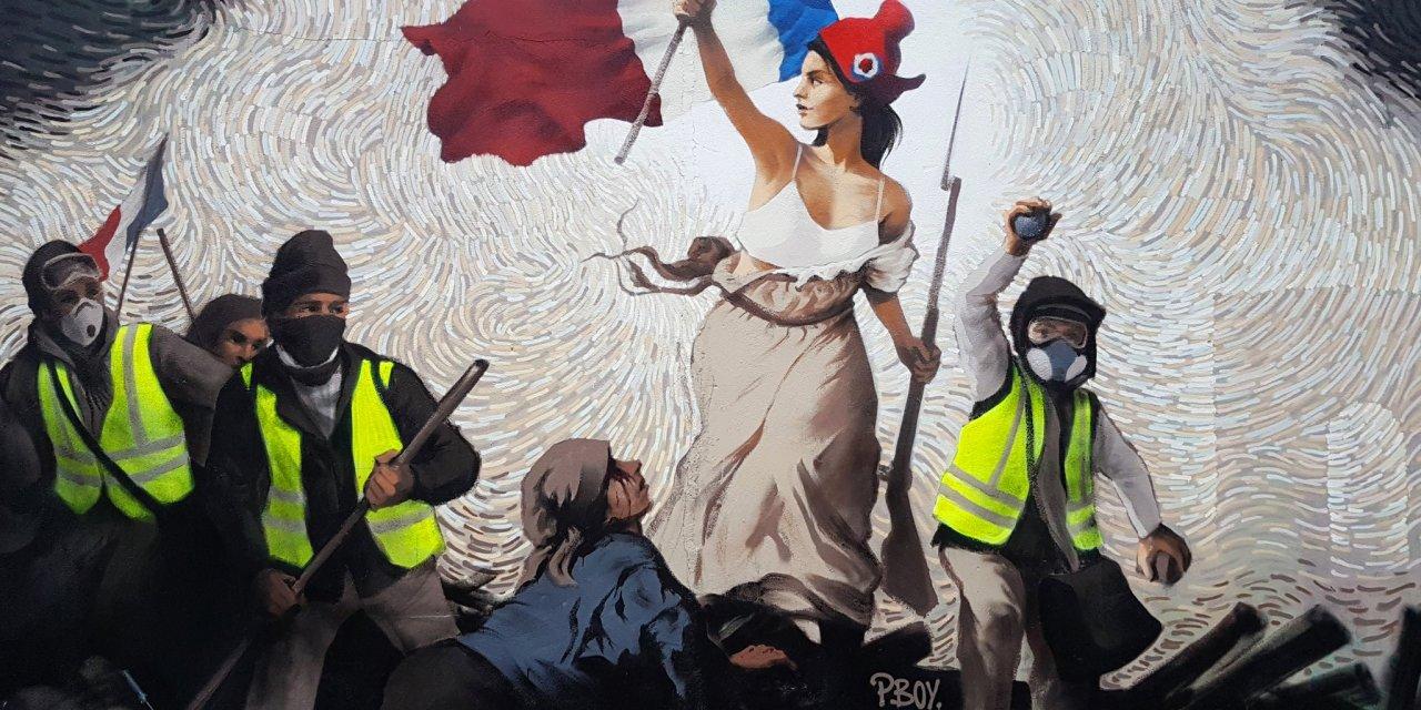 Mural alusivo a protestas en Paris oculta premio en bitcoins