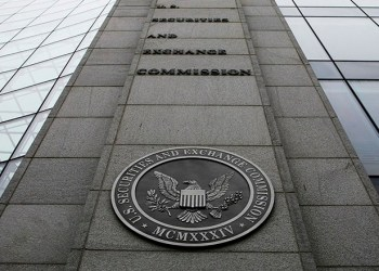 FILE- In this file photo made Dec. 17, 2008, shows the exterior of the Securities and Exchange Commission (SEC) headquarters in Washington. Federal regulators filed civil fraud charges against an investment adviser and his firm in connection with complex securities tied to mortgages during the housing market bust. (AP Photo/File)