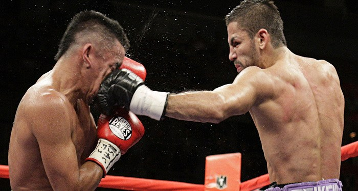 Rocky Juarez of the U.S. gets punched in the face in July 2010 by Jorge Linares of Venezuela during their WBA Fedelatin lightweight title fight in Las Vegas. Some researchers believe the human face evolved to take punches — without, of course, the boxing glove