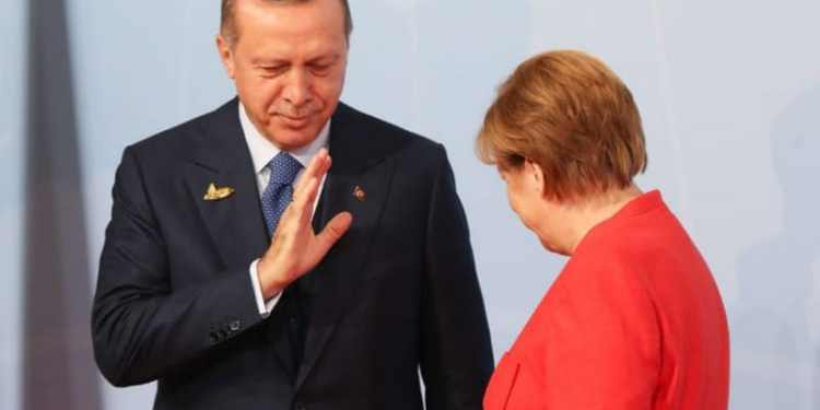 HAMBURG, GERMANY - JULY 07:  German Chancellor Angela Merkel (R) welcomes Turkish President Recep Tayyip Erdogan at the start of the the G20 summit on July 7, 2017 in Hamburg, Germany. Leaders of the G20 group of nations are meeting for the July 7-8 summit. Topics high on the agenda for the summit include climate policy and development programs for African economies.  (Photo by Matt Cardy/Getty Images)