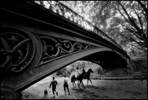 USA. New York City. 1992. Horseback riders and bridge in Central Park. - © Bruce Davidson