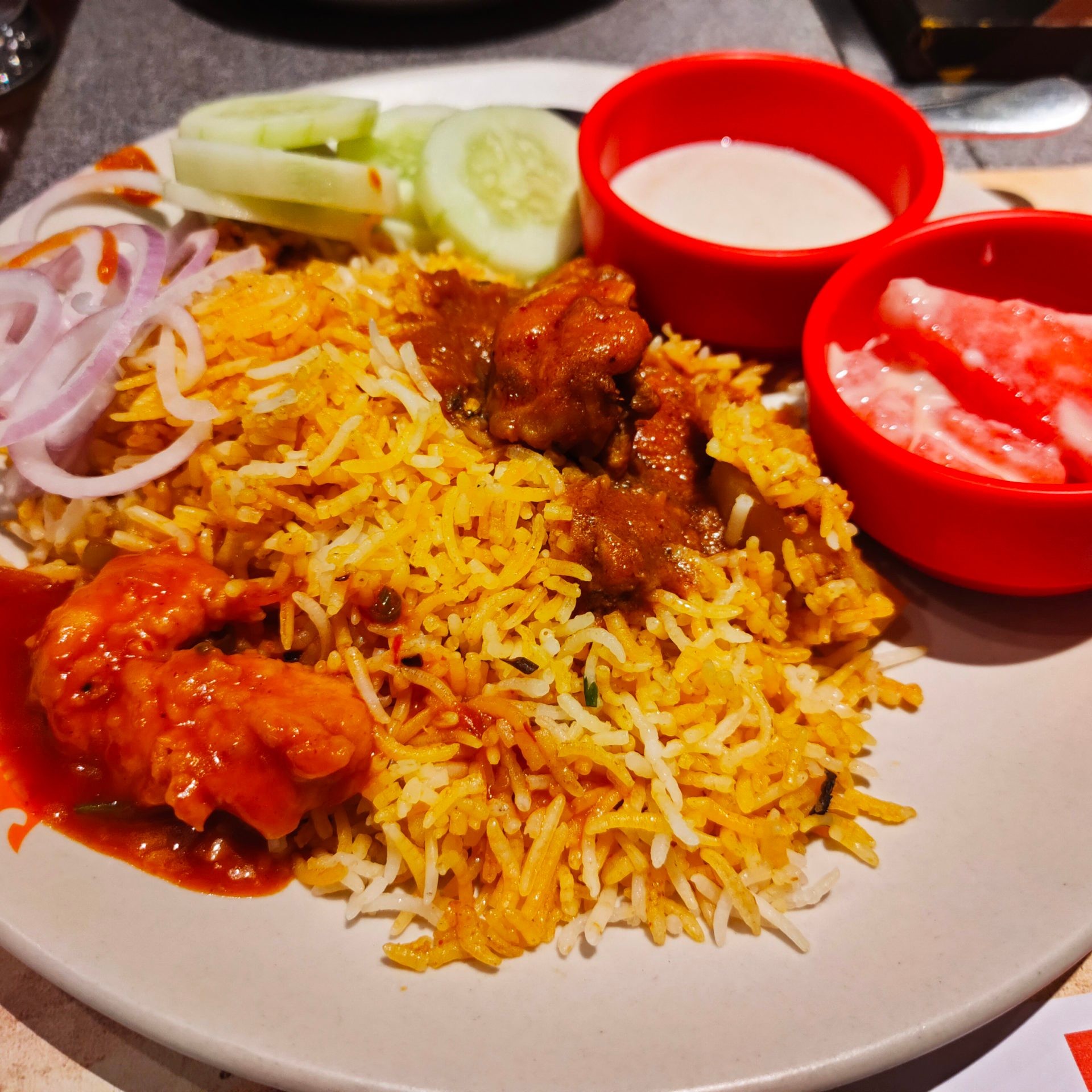 BBQ Nation - CHICKEN DUM BIRYANI, KADHAI CHICKEN, Green Salad, Raita, Fruit Salad