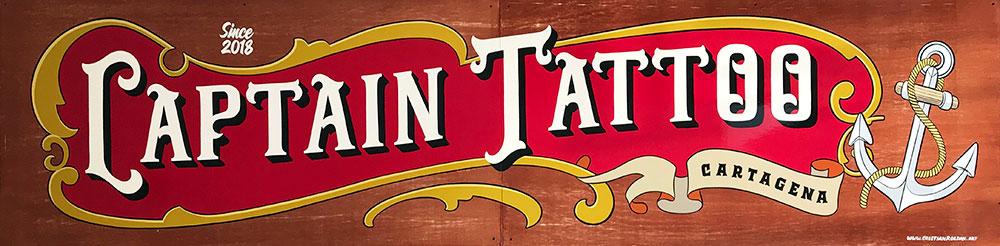 Rotulo-pintado-a-mano-sobre-madera-tattoo-studio-tattoshop