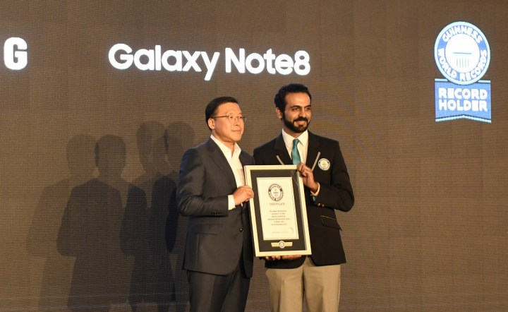 Chung Lyong Lee, President of Samsung Gulf Electronics receiving the Guinness World Record certificate the Guinness World Record certificate for the World's Biggest LED Structure