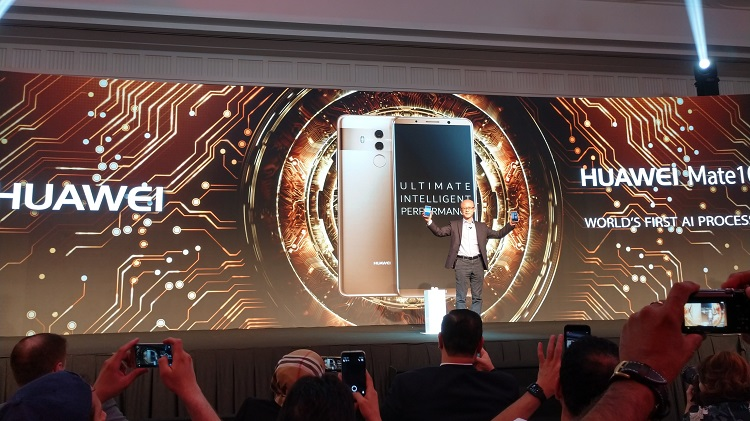 Mr. Gene Jiao, President of Huawei CBG, MEA shows Huawei Mate 10 and Mate 10 Pro