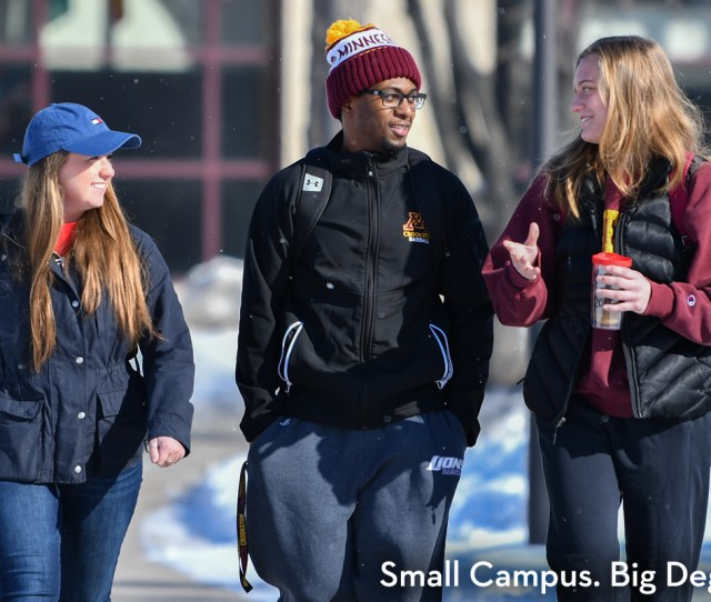 Three Students Walking In Front Of Sargeant Student Center Outside During The Winter Talking With Small