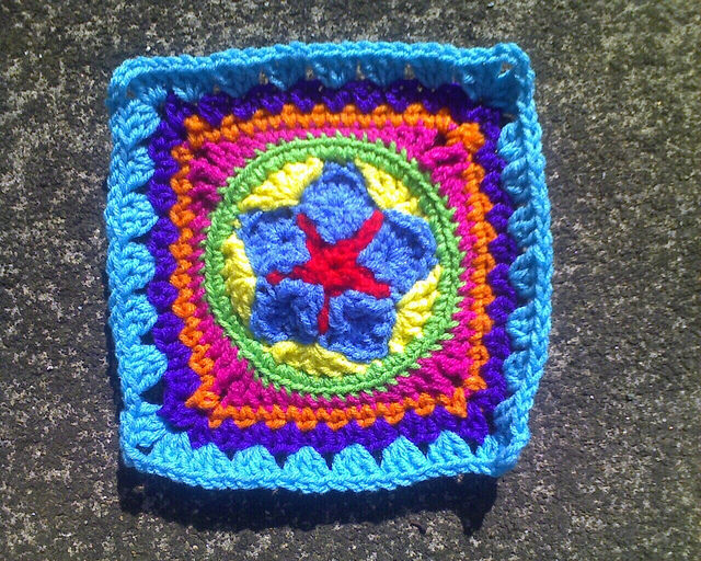 Crochet granny square with a crochet star in the center