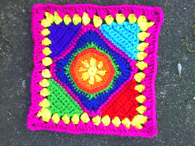 crochet square with crochet triangle corners