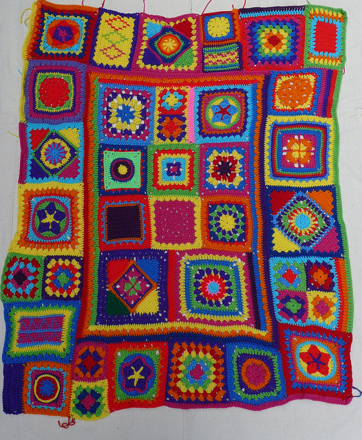 Multicolor crochet granny square afghan needing a crochet border