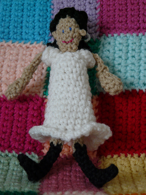 front of a crochet doll
